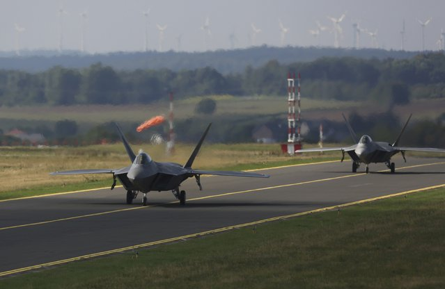 Two U.S. Air Force F-22 Raptor fighter jets taxi on tarmac at the Spangdahlem Air base, Germany September 3, 2015. (Photo by Ina Fassbender/Reuters)