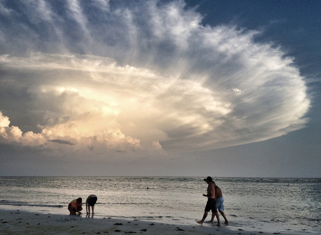 Storm's Backside: Evening stroll on Siesta Key Beach in Sarasota, Florida – voted no. 1 beach in the country. (Photo by Judy Robertson/National Geographic Photo Contest