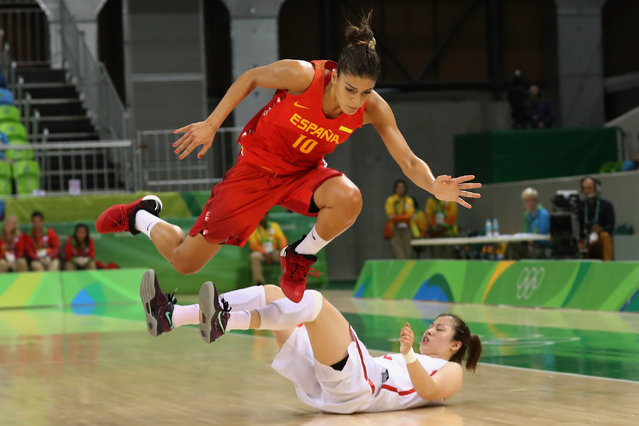 Marta Xargay #10 of Spain jumps over Xiaojia Chen #5 of China in the Women's Basketball Preliminary Round Group B match between China and Spain on Day 5 of the Rio 2016 Olympic Games at Youth Arena on August 10, 2016 in Rio de Janeiro, Brazil. (Photo by Rob Carr/Getty Images)