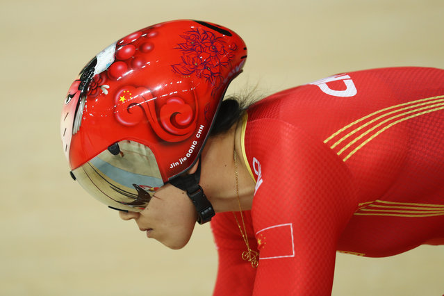 Jinjie Gong of China races during the Women's Sprint 1/6 Final against Elis Ligtlee of the Netherlands on Day 9 of the Rio 2016 Olympic Games at the Rio Olympic Velodrome on August 14, 2016 in Rio de Janeiro, Brazil. (Photo by Bryn Lennon/Getty Images)