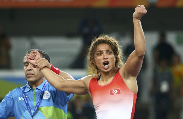 2016 Rio Olympics, Wrestling, Final, Women's Freestyle 58 kg Bronze, Carioca Arena 2, Rio de Janeiro, Brazil on August 17, 2016. The referee raises the hand of Maroua Amri (TUN) of Tunisia after her victory over Yulia Ratkevich (AZE) of Azerbaijan. (Photo by Ruben Sprich/Reuters)