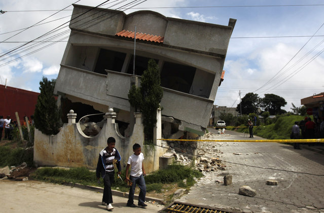 An earthquake-damaged house is pictured in the San Marcos region, in the northwest of Guatemala, July 7, 2014. (Photo by Jorge Dan Lopez/Reuters)