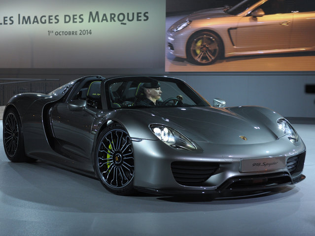 A Porsche 918 Spyder is presented at the Volkswagen Group Night show on October 1, 2014 in Paris  prior to the opening on October 2 of the Paris Auto show 2014 Press days. (Photo by Eric Piermont/AFP Photo)