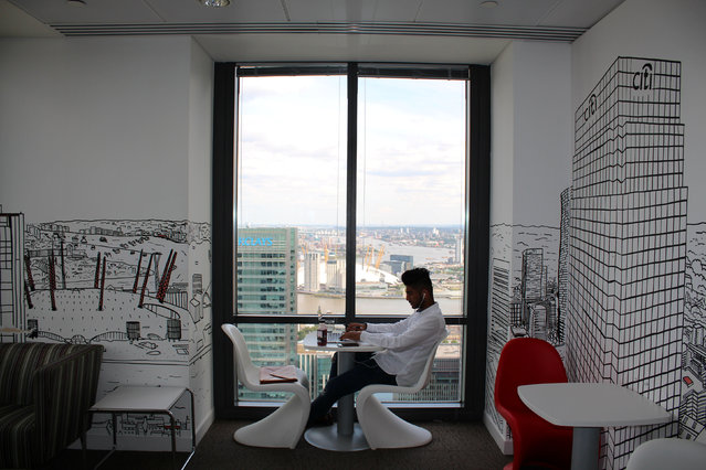 A man uses a laptop in the Level39 FinTech hub based in the One Canada Square tower of the Canary Wharf district of London, Britain, August 5, 2016. (Photo by Jemima Kelly/Reuters)