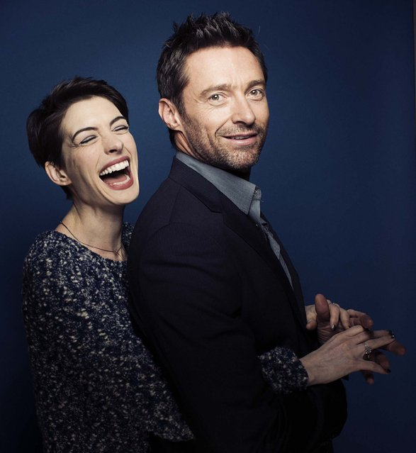 """Anne Hathaway and Hugh Jackman, co-stars of the film """"Les Miserables"""", pose for a portrait in New York December 2, 2012. (Victoria Will/Invision)"""