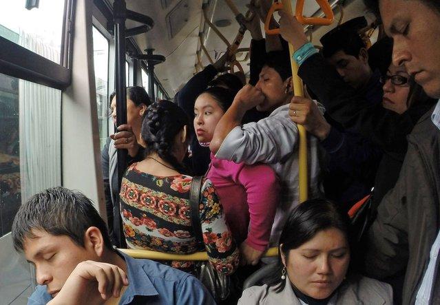 Passengers ride a packed Metropolitano public bus in downtown Lima, October 28, 2014. (Photo by Enrique Castro-Mendivil/Reuters)