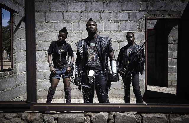 """""""Edith, Hellrider, and Dadmonster pose for a photograph. In Botswana, heavy metal music has landed. Metal groups are now performing in nightclubs, concerts, festivals. The ranks of their fans have expanded dramatically. These fans wear black leather pants and jackets, studded belts, boots and cowboy hats. (Photo and comment by Daniele Tamagni, Italy/2013 Sony World Photography Awards"""