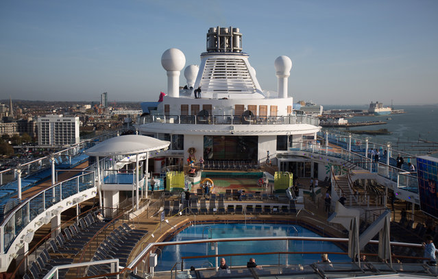 People sit and enjoy the facilites on the top deck onboard the cruise ship Quantum of the Seas which is currently docked at Southampton on October 31, 2014 in Southampton, England. (Photo by Matt Cardy/Getty Images)