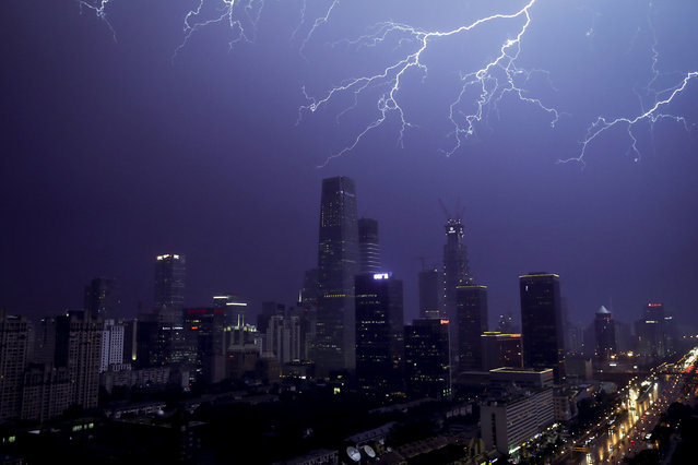 Lightning flashes above skyscrapers in Central Business District during a rainstorm in Beijing, Wednesday, September 7, 2016. (Photo by Andy Wong/AP Photo)