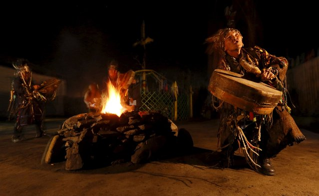 Shamans, representing the so-called Adyg Eeren (Bear Spirit) society, participate in the so-called Kamlanie night ritual upon the request of customers, including local residents and foreigners, in the town of Kyzyl, the administrative centre of Tuva region, Southern Siberia, Russia, October 9, 2015. (Photo by Ilya Naymushin/Reuters)