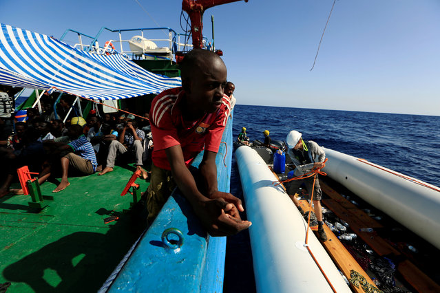 A migrant is seen onboard of Iuventa vessel after he was rescued from an overcrowded dinghy by members of the German NGO Jugend Rettet during an operation, off the Libyan coast in the Mediterranean Sea September 21, 2016. (Photo by Zohra Bensemra/Reuters)