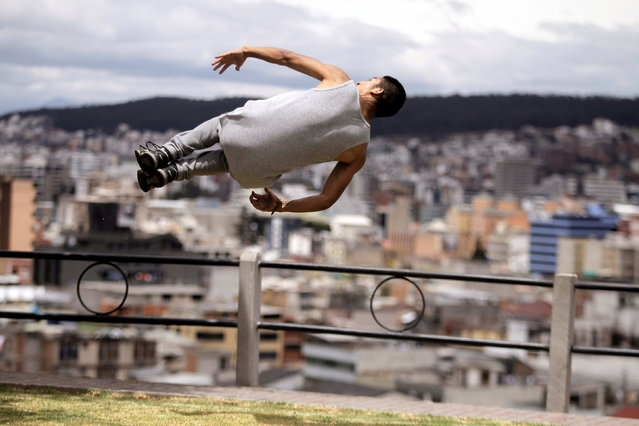 Daniel Macas a parkour practitioner rolls over in the air at a park in Quito, September 25, 2016. (Photo by Kevin Granja/Reuters)