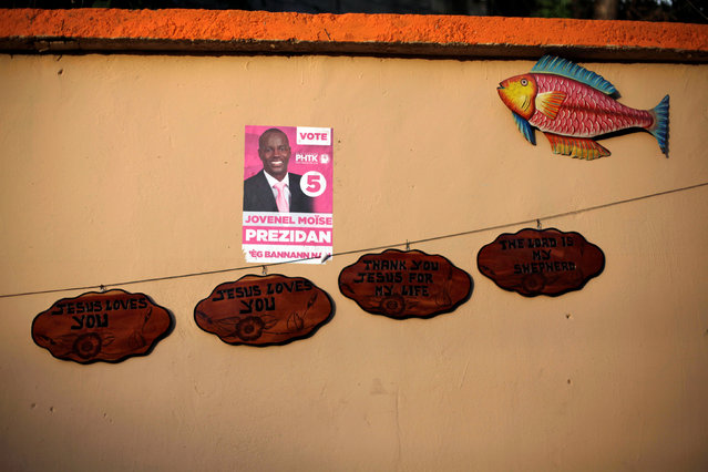 An electoral poster of presidential candidate Jovenel Moise plastered on a wall at a handcraft store in a street of Port-au-Prince, Haiti, September 21, 2016. (Photo by Andres Martinez Casares/Reuters)