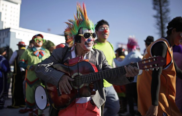 People take part in National Clown Day celebrations at Beethoven Square in San Salvador December 3, 2014. (Photo by Jose Cabezas/Reuters)