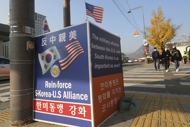"""Banners to support the alliance between South Korea and the U.S. are displayed near the U.S. Embassy in Seoul, South Korea, Thursday, November 12, 2020. The office of South Korean President Moon Jae-in said Biden during their 14-minute call reaffirmed the U.S. commitment to defend South Korea and said he would closely coordinate with Seoul in a push to defuse a nuclear standoff with North Korea. The sign at top reads """"Anti-China and Pro-the U.S."""". (Photo by Ahn Young-joon/AP Photo)"""
