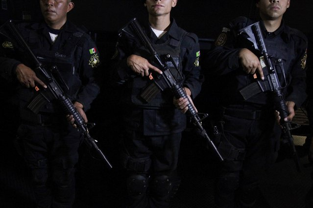 Members of the Fuerza Civil (Civil Force) police unit pose for a picture during a media presentation to show the police model that the federal government wants for the rest of the country, at the police academy in Monterrey December 17, 2014. (Photo by Daniel Becerril/Reuters)