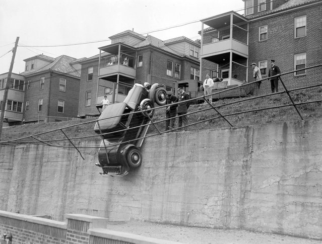 Fence keeps car from falling, Brookline, 1931. (Photo by Leslie Jones)
