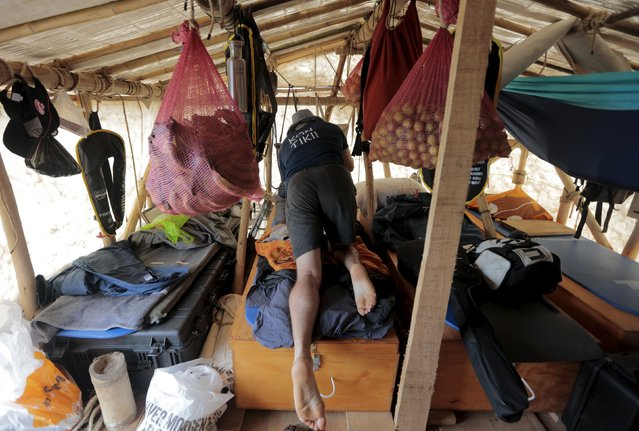 A crew member of a wooden raft of the Kon-Tiki2 expedition prepares the cabin before its departure from Peru's Callao Naval Shipyard in Peru, November 7, 2015. (Photo by Guadalupe Pardo/Reuters)