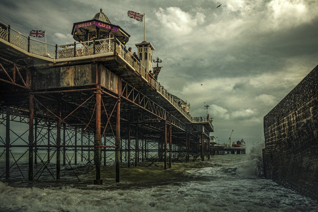 "Overall Winner: The Brighton Palace Pier. ""Standing in the full force of weather and time: the Brighton Palace Pier. My wife and I have been visiting Brighton for a few years now and I always strive to capture this lovely historic seaside town with a sense of the atmosphere and cinematic interpretation that it instills in me"". (Photo by Michael Marsh/Historic Photographer of the Year 2020)"