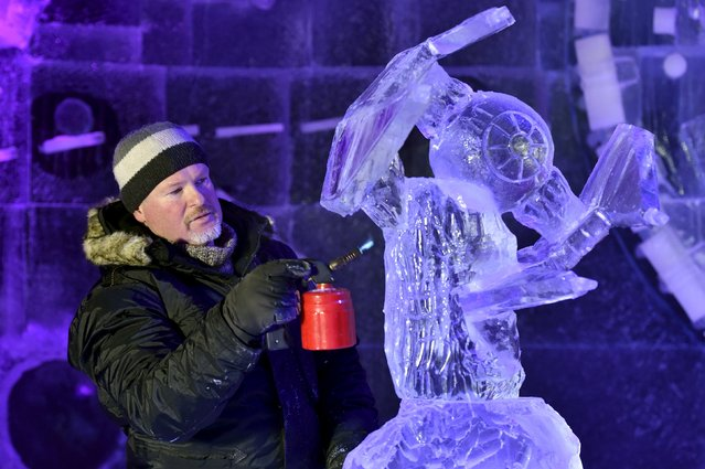 Hungary's Andras Viski carves a Star Wars spacecraft for the ice sculpture festival in Liege, Belgium, November 13, 2015. (Photo by Eric Vidal/Reuters)