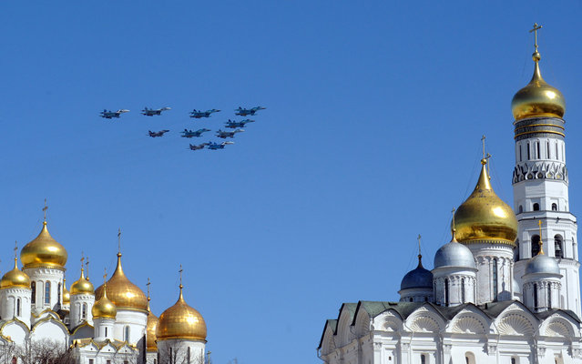 Russian army jet fly over an Orthodox Christian church during a rehearsal for the Victory Day parade in Moscow. Russia marks victory over Nazi Germany in World War Two every year on May 9. (Photo by Andrey Smirnov/AFP Photo)