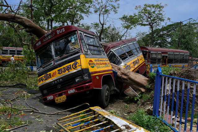 A private bus being crushed in half by a fallen tree due to Cyclone Amphan in Kolkata, West Bengal, India on May 22, 2020. The wreckage still exists after two day since Super cyclone Amphan hit the States of Bengal and Orissa.There are massive destruction of properties and life.All together the cyclone claimed about 76 lives across India and Bangladesh. The CM of West bengal has declared a package of 2.5 Lakhs for the family of the deceased in the state. (Photo by Debarchan Chatterjee/ZUMA Wire/Rex Features/Shutterstock)