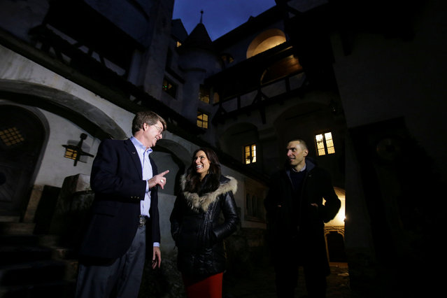 Tami and Robin Varma are greeted by Dacre Stoker, great-grand nephew of Dracula Gothic novel writer Bram Stoker, inside the courtyard of Bran Castle, in Brasov county, Romania, October 31, 2016. (Photo by Octav Ganea/Reuters/Inquam Photos)