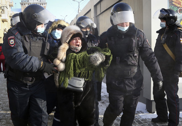 Police detain a woman during a protest against the jailing of opposition leader Alexei Navalny in Siberian city of Omsk, Russia, Saturday, January 23, 2021. (Photo by AP Photo/Stringer)