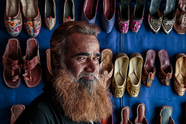 """""""Shoes Seller"""". Portrait of a shoes seller in the city of Jaipur. Location: Jaipur, Rajasthan, India. (Photo and caption by Massimiliano De Santis/National Geographic Traveler Photo Contest)"""