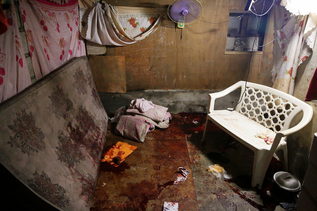 Blood of victims is pictured splattered inside a house in Manila, Philippines early November 1, 2016. (Photo by Damir Sagolj/Reuters)