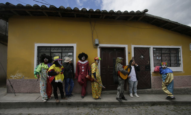 Indigenous men in costume go from house to house to dance and chant as part of the Sun Festival in Peguche, Ecuador, Sunday, June 24, 2018. (Photo by Dolores Ochoa/AP Photo)