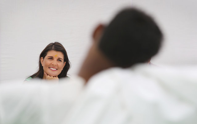 In this  Wednesday, June 27, 2018, file photo, U.S. Ambassador to United Nations Nikki Haley watches a dance drama at Mukhti Ashram, a shelter for rescued child labor, in New Delhi, India. Haley is on a two day visit to India during which she will meet Indian prime minister, senior Indian officials, business leaders and students. (Photo by Manish Swarup/AP Photo/File)