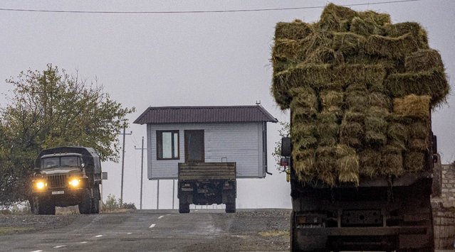 A truck carries a barn as Armenian refugees leave the village of Nor Maragha near Agdam on November 18, 2020. As part of the deal, Armenia and Nagorno-Karabakh must return the Aghdam, Kalbajar and Lachin districts to Azerbaijan starting on November 20, with a completion deadline of December 1. (Photo by Andrey Borodulin/AFP Photo)