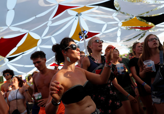 Festivalgoers dance during the Balaton Sound music festival in Zamardi, Hungary, July 5, 2018. (Photo by Bernadett Szabo/Reuters)