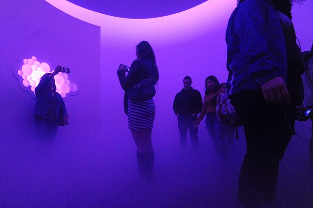 """People interact with the """"calm"""" room at the Museum of Feelings, a pop-up installation in New York, December 15, 2015. (Photo by Stephanie Keith/Reuters)"""