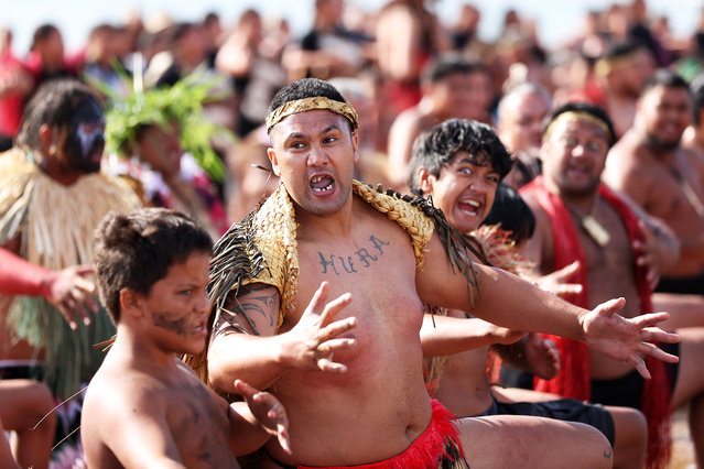 The Waka land on the beach and a haka is performed on February 06, 2021 in Waitangi, New Zealand. The Waitangi Day national holiday celebrates the signing of the treaty of Waitangi on February 6, 1840 by Maori chiefs and the British Crown, that granted the Maori people the rights of British Citizens and ownership of their lands and other properties. (Photo by Fiona Goodall/Getty Images)