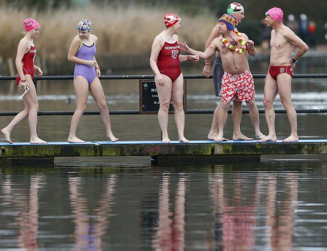 Swimmers prepare to take part in the annual Christmas Day Peter Pan Cup handicap race in the Serpentine River, in Hyde Park, London, December 25, 2015. (Photo by Andrew Winning/Reuters)