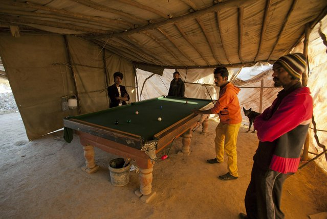Pakistani boys play pool in a makeshift club in an Islamabad slum, Wednesday, February 11, 2015 in Pakistan. (Photo by B. K. Bangash/AP Photo)