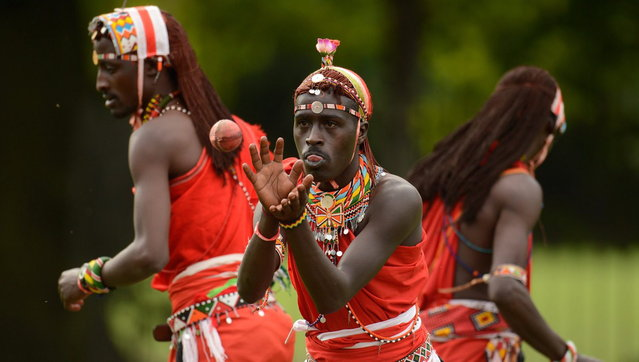 "Tepele Francis Siranga Naimando (C) of the Maasai cricket warriors team from Kenya catches a ball before a cricket match against English team ""The Shed"" during the ""Last Man Stands"" cricket tournament at Dulwich sports ground in South London September 1, 2013. (Photo by Philip Brown/Reuters)"