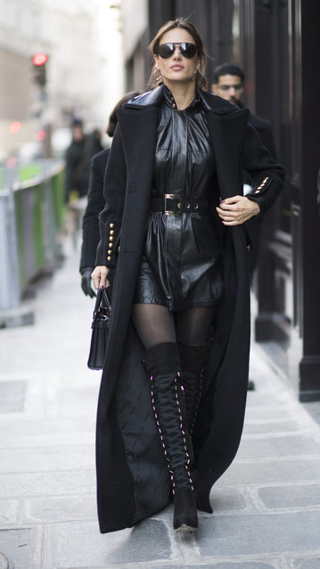 Alessandra Ambrosio is seen wearing Ellery dress, Versace belt, Wolford tights, Elizabeta Franci boots, Dsquared coat, before the Victorias Secret rehearsal in the streets of Paris on November 29, 2016 in Paris, France. (Photo by Timur Emek/GC Images)