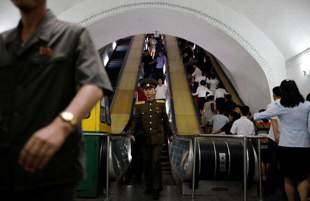 Commuters ride escalators at a subway station in Pyongyang, North Korea on September 11, 2018. (Photo by Danish Siddiqui/Reuters)