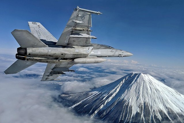 A US F/A-18F super hornet flies past Mount Fuji, an active volcano and the highest peak in Japan at 3,776m on January 2020. (Photo byAlex Grammar /Reuters)