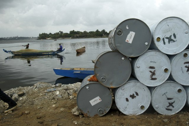Used oil barrels are collected on a lake side at the barrel market in Treichville, an area of Abidjan on February 12, 2015. (Photo by Luc Gnago/Reuters)