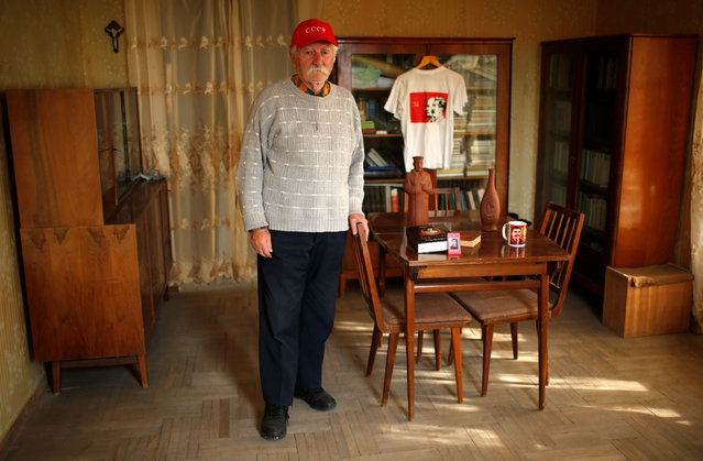 """Retired engineer Guram Kardanakhishvili, 86, poses for a portrait at his home where he lives alone in Tbilisi, Georgia, November 25, 2016. """"I have been a fan of Stalin since school"""", Kardanakhishvili said. """"He cared for his people. He is very popular among older people because life was better under his rule, there were lower prices and higher salaries but the younger don't know about that"""". (Photo by David Mdzinarishvili/Reuters)"""