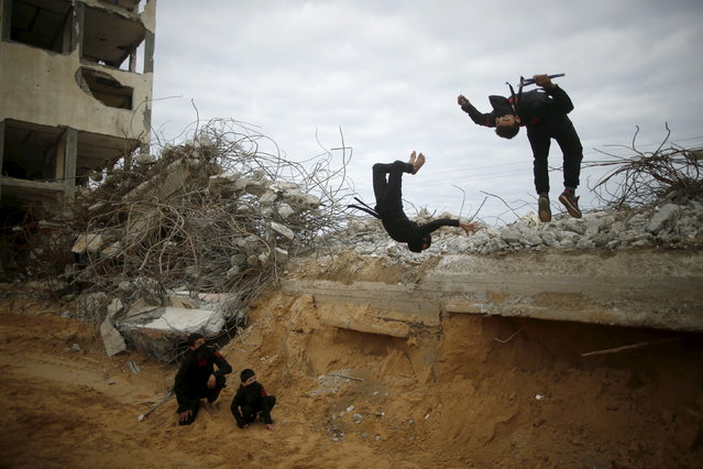 A Palestinian youth and a boy jump as they demonstrate their ninja-style skills for a photographer at the ruins of a building, that was destroyed in the 2014 war, in the northern Gaza Strip January 29, 2016. (Photo by Mohammed Salem/Reuters)