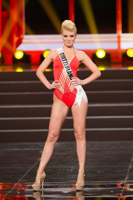 A handout picture provided by the Miss Universe Organization shows Dominique Rinderknecht, Miss Switzerland 2013, competing in the swimsuit competition during the Preliminary Competition at the Crocus City Hall, in Moscow, Russia, 05 November 2013. (Photo by Darren Decker/EPA)