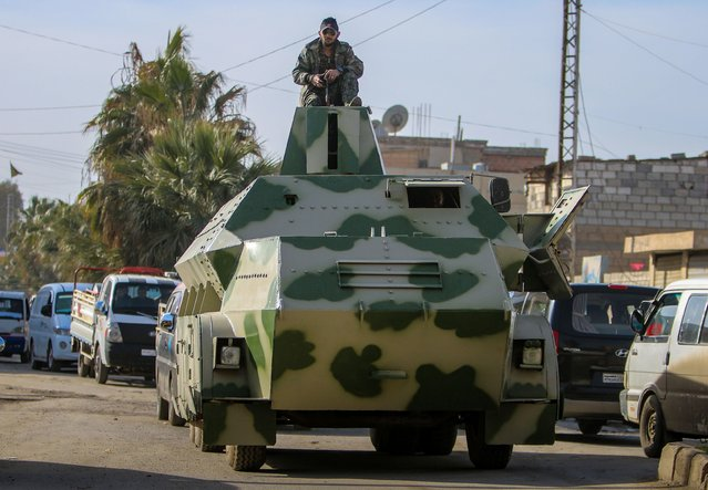Fighters of the Kurdish People's Protection Units (YPG) drive a makeshift armoured vehicle along a street in the northeastern province of al-Hasaka, February 2, 2015. (Photo by Rodi Said/Reuters)