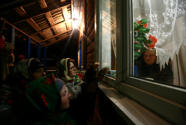 "People celebrate the pagan rite called ""Kolyadki"" and mark the New Year, according to the Julian calendar on January 13, in the village of Vosava, Belarus January 13, 2017. (Photo by Vasily Fedosenko/Reuters)"