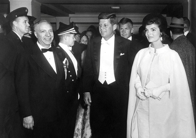 John F. Kennedy and Jacqueline Kennedy arrive at the National Guard Armory for the inaugural ball in Washington, D.C., U.S. in January 1961. Ethel Frankau of Bergdorf Custom Salon designed the first lady's sleeveless gown and matching cape. (Photo by Reuters/John F. Kennedy Presidential Library & Museum)