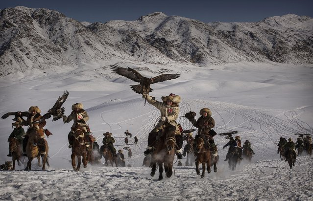 Kevin Frayer, Canada. Shortlist, Professional , Environment. January 30, 2015 in Xinjiang, China. The Eagle Hunting festival, organised by the local hunting community, is part of an effort to promote and grow traditional hunting practices for new generations in the mountainous region of western China that borders Kazakhstan, Russia and Mongolia. The training and handling of the large birds of prey follows a strict set of ancient rules that Kazakh eagle hunters are preserving for future generations. (Photo by Kevin Frayer/Sony World Photography Awards)